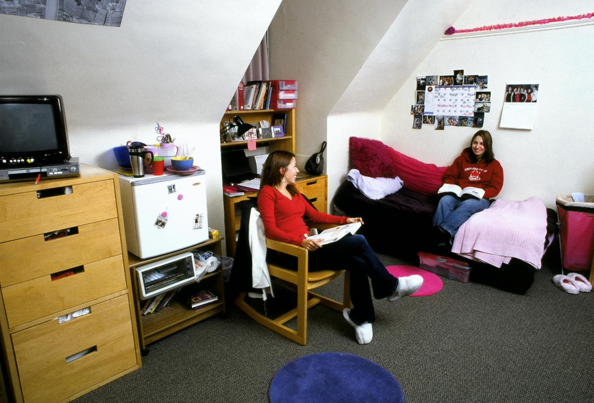 Picture of two female students in a residence room.