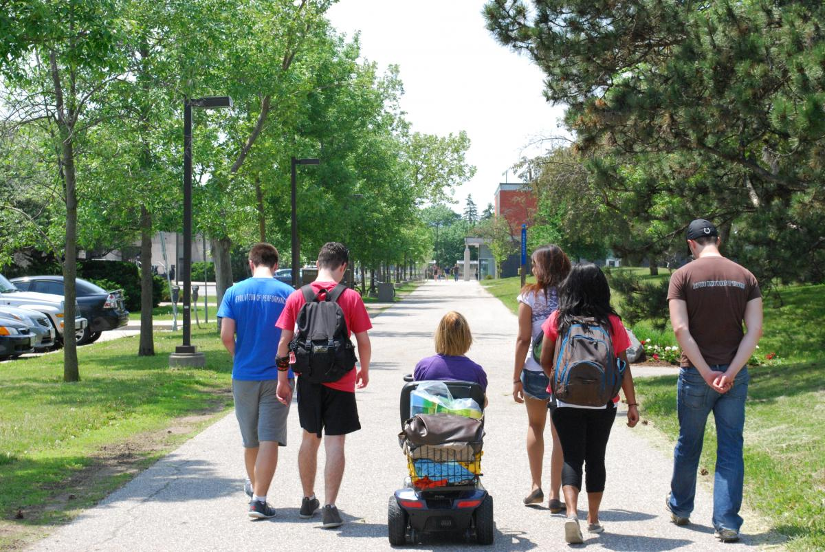 Picture of students walking on campus.