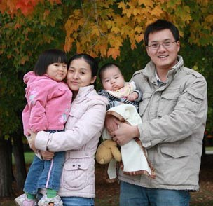 Picture of a family, in the fall, from Family Housing.